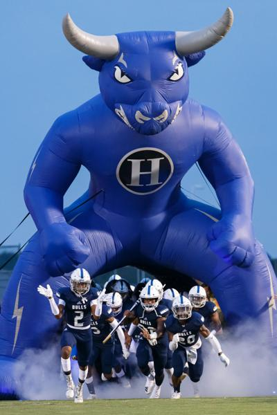 The Hickory Ridge Ragin' Bulls defeat the Cox Mill Chargers 38-30 to remain undefeated.