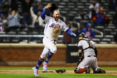 Pete Alonso of the New York Mets celebrates after scoring the game-winning run in the bottom of the 10th inning against the Arizona Diamondbacks at Citi Field in New York on Friday, May 7, 2021.