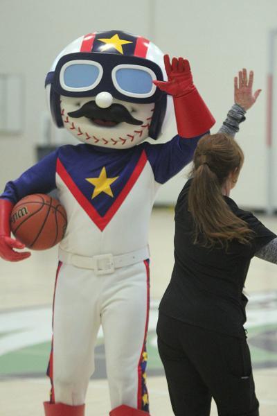 "Kannapolis Middle School nurse Barbara Jackson and Cannon Ballers Mascot ""Boomer"""