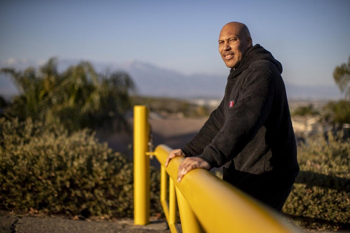 CHINO HILLS, CA- MARCH 16, 2021: LaVar Ball stands at a trailhead where he use to train his sons in their early years across from Chino Hills State Park on March 16, 2021 in Chino Hills, California.