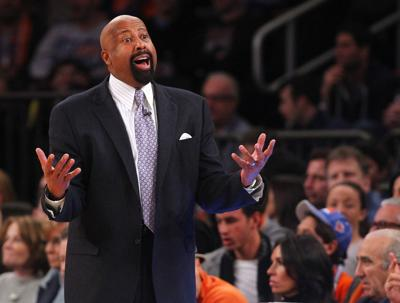 Head coach Mike Woodson of the New York Knicks yells to a ref during the second half of a game against the Miami Heat at Madison Square Garden on February. 1, 2014 in New York City.