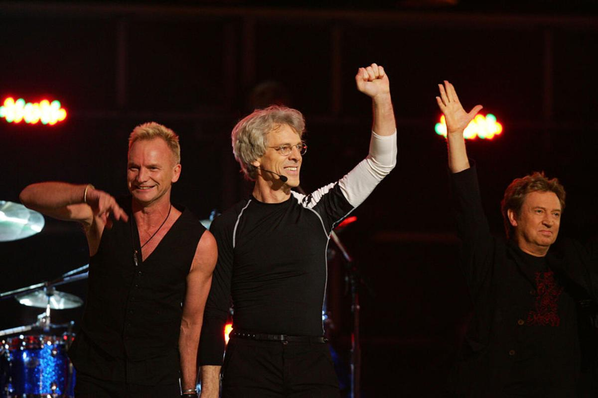 Five-time Grammy winners The Police, reuniting singer Sting, drummer Stewart Copeland and guitarist Andy Summers wave after performing at the 49th Grammy Awards in Los Angeles on February 11, 2007.