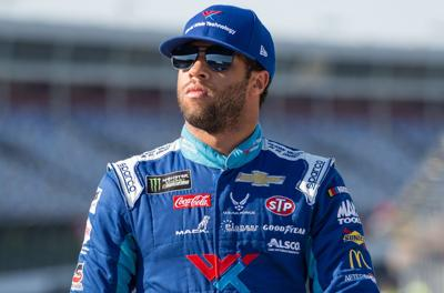 Bubba Wallace, driver of the World Wide Technology (43) strolls through pit lane on Friday of the 2019 Monster Energy NASCAR All-Star Race Weekend at Charlotte Motor Speedway.