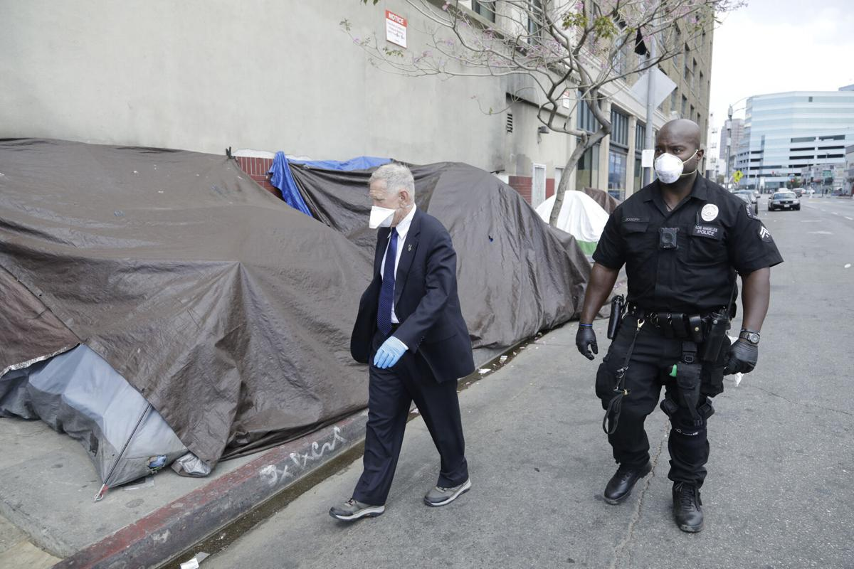 U.S. District Court judge David O. Carter tours Skid Row in Los Angeles with LAPD officer Deon Joseph on April 3, 2020.