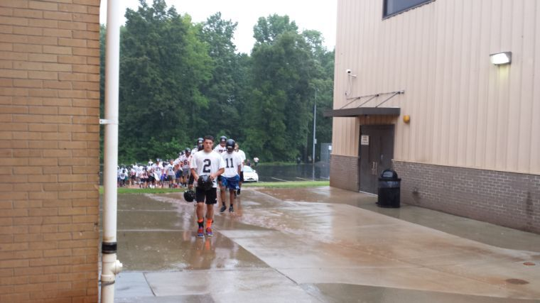 Trojans march to practice