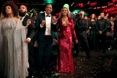 From left, singer Solange Knowles, Alan Ferguson, hip-hop artist Jay-Z and singer Beyonce during The 59th Grammy Awards at Staples Center on Feb. 12, 2017, in Los Angeles.
