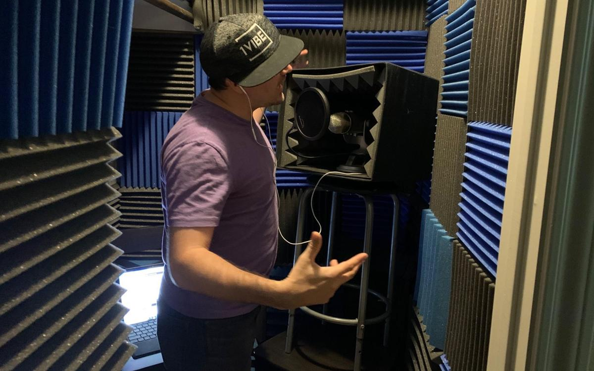 "In the sound booth: Brock Scott raps lyrics for his ""Fart Head and Ned Save Earth"" video,"