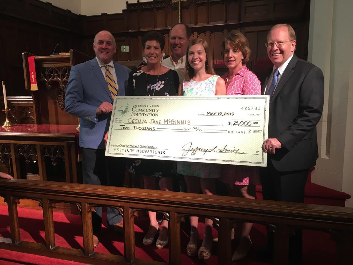 Askew and McGinnis receive memorial scholarship award