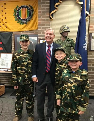 Young guys in soldier uniforms attend Salute to Veterans