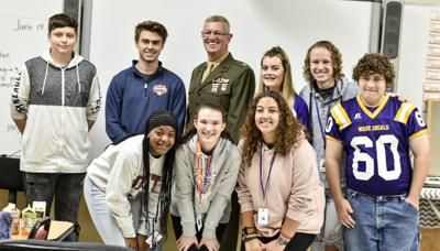 Local vet speaks at high school