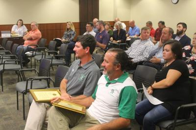 AHS coaches get plaques from county council