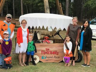 Beyond Abuse with a Flintstones theme for trunk-or-treat at Greenwood YMCA
