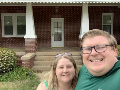 James and Marie Hicks in front of house