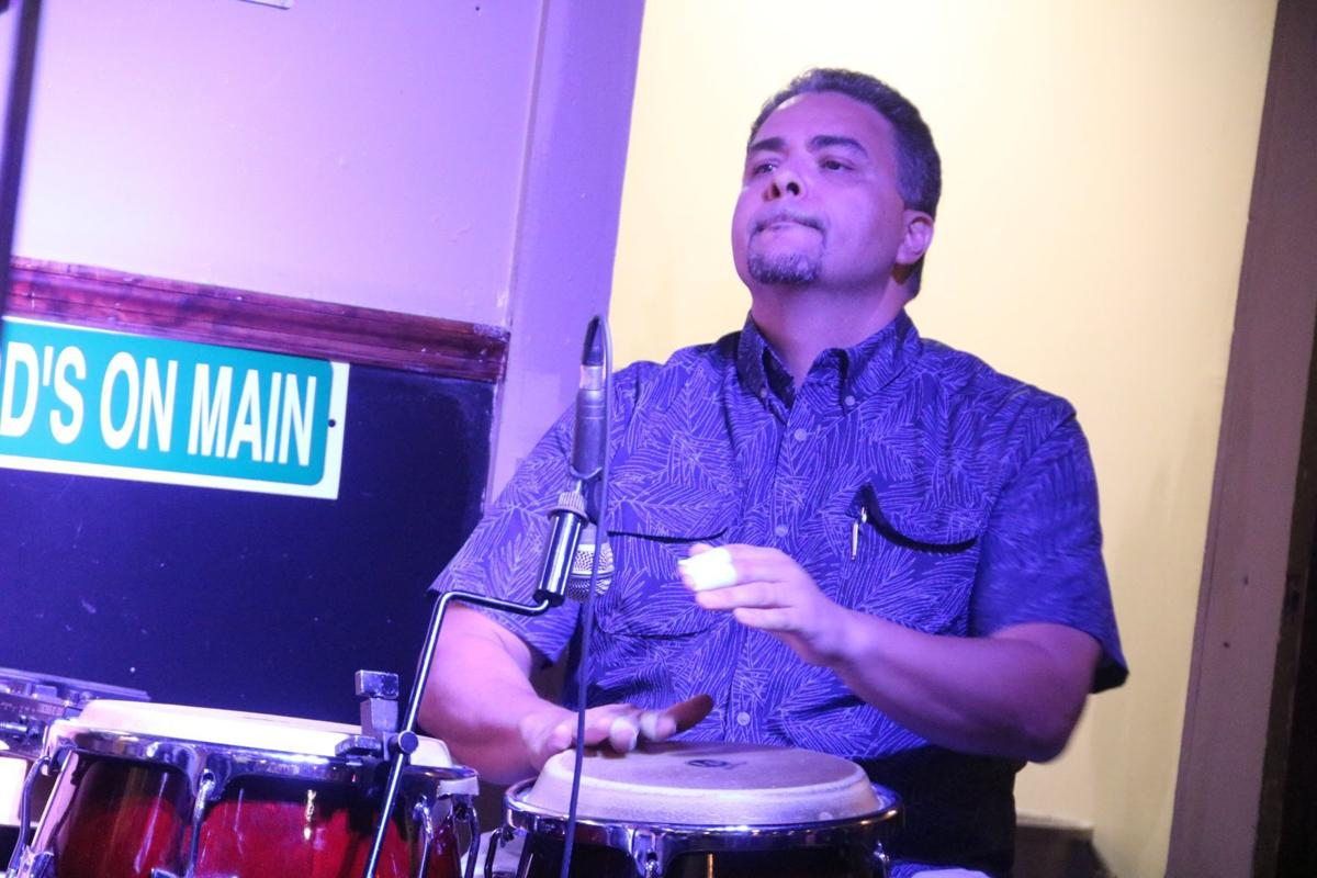 Ismario Gonzalez on percussion during the concert at Howard's on Main, in memory of Alex