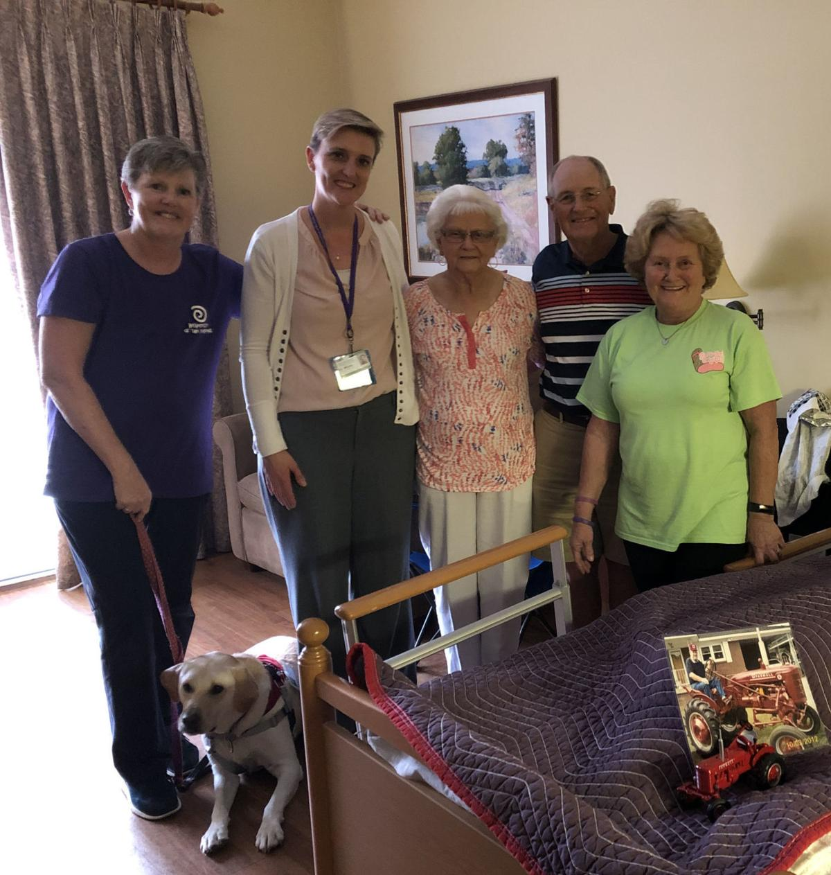 Touching gesture from Hospice and Palliative Care of the Piedmont volunteer