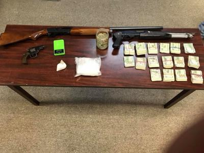 Cash, guns, drugs