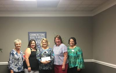 GMFCU makes donation to Cornerstone
