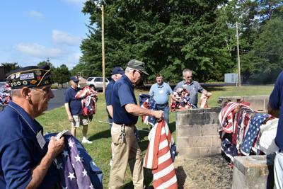 American Legion members conduct flag disposal ceremony