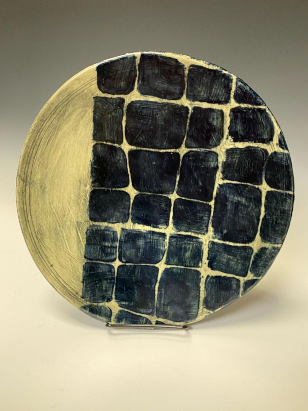 A clay plate by Laura Bachinski, inspired by her interest in indigo-dyed textiles.