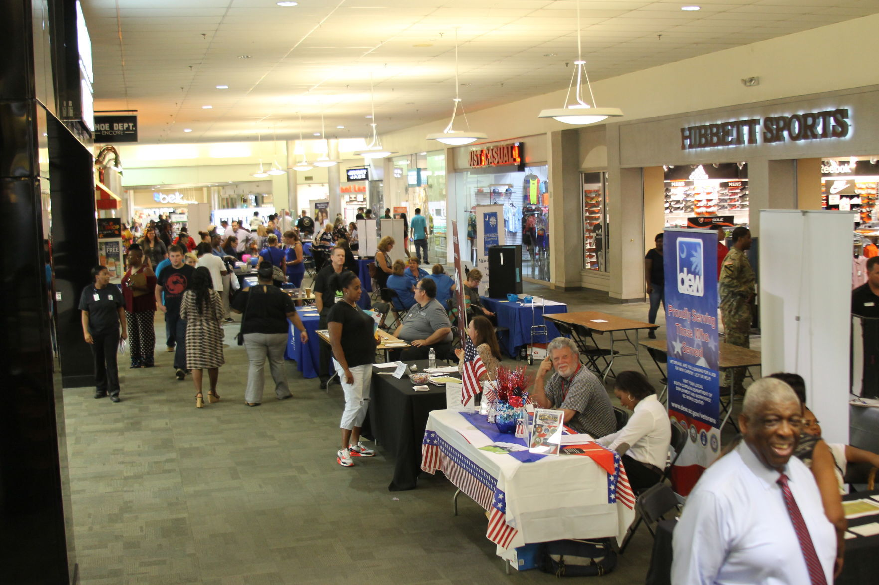 People mill about the Greenwood Mall during