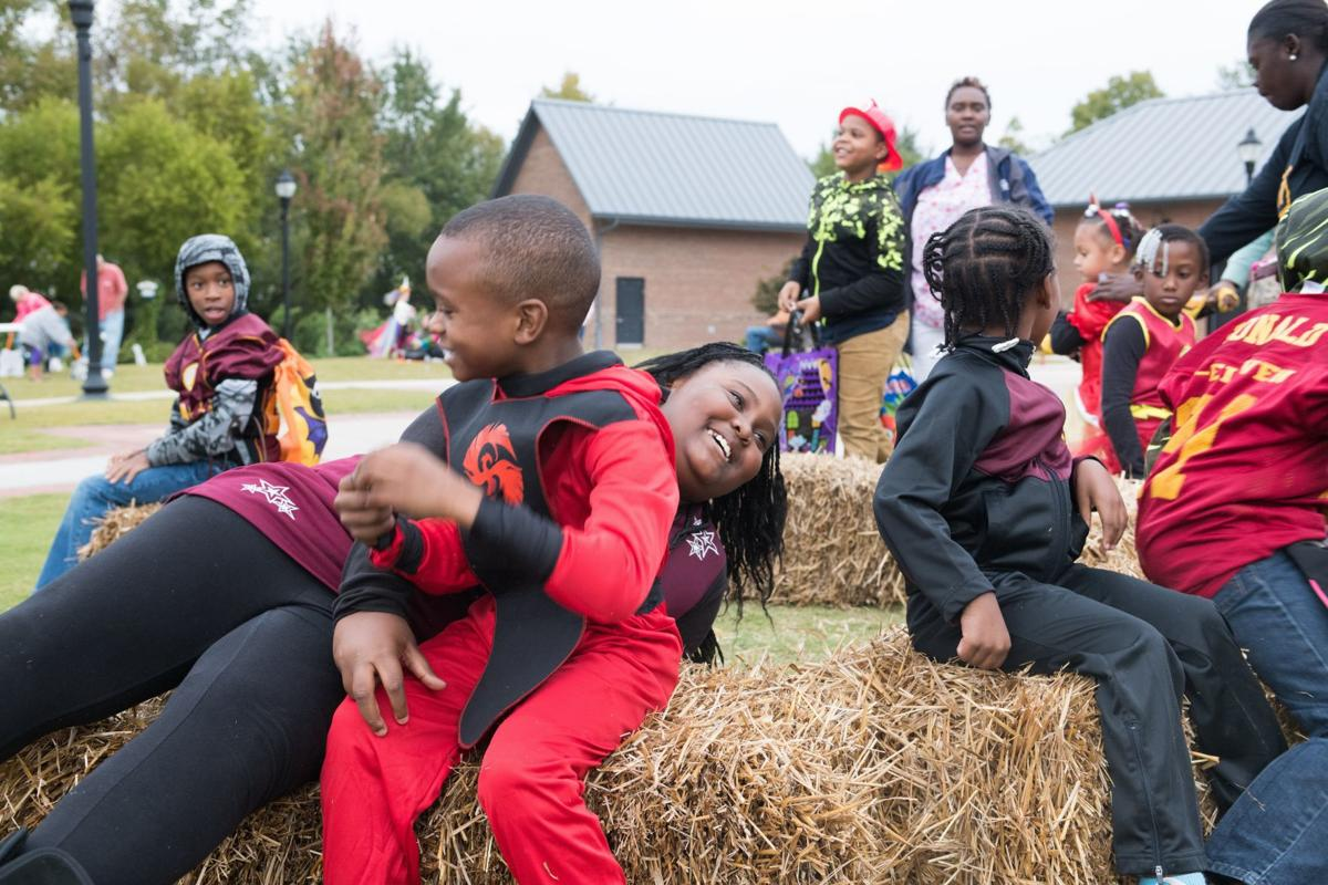 Hay rides, games, candy, prizes, costumes and more at Uptown's Boo Bash Thursday