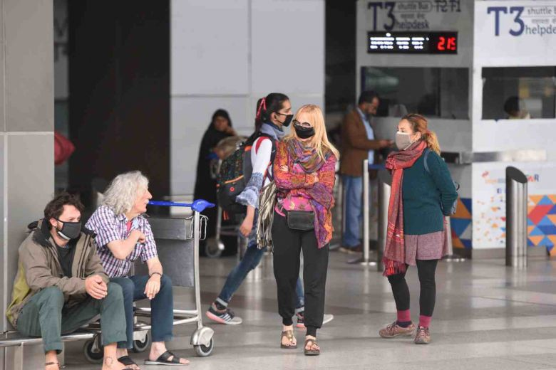 India bans incoming international flights for a week over virus