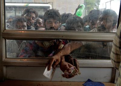 Call waiting: Kashmiris queue for two-minute phone access