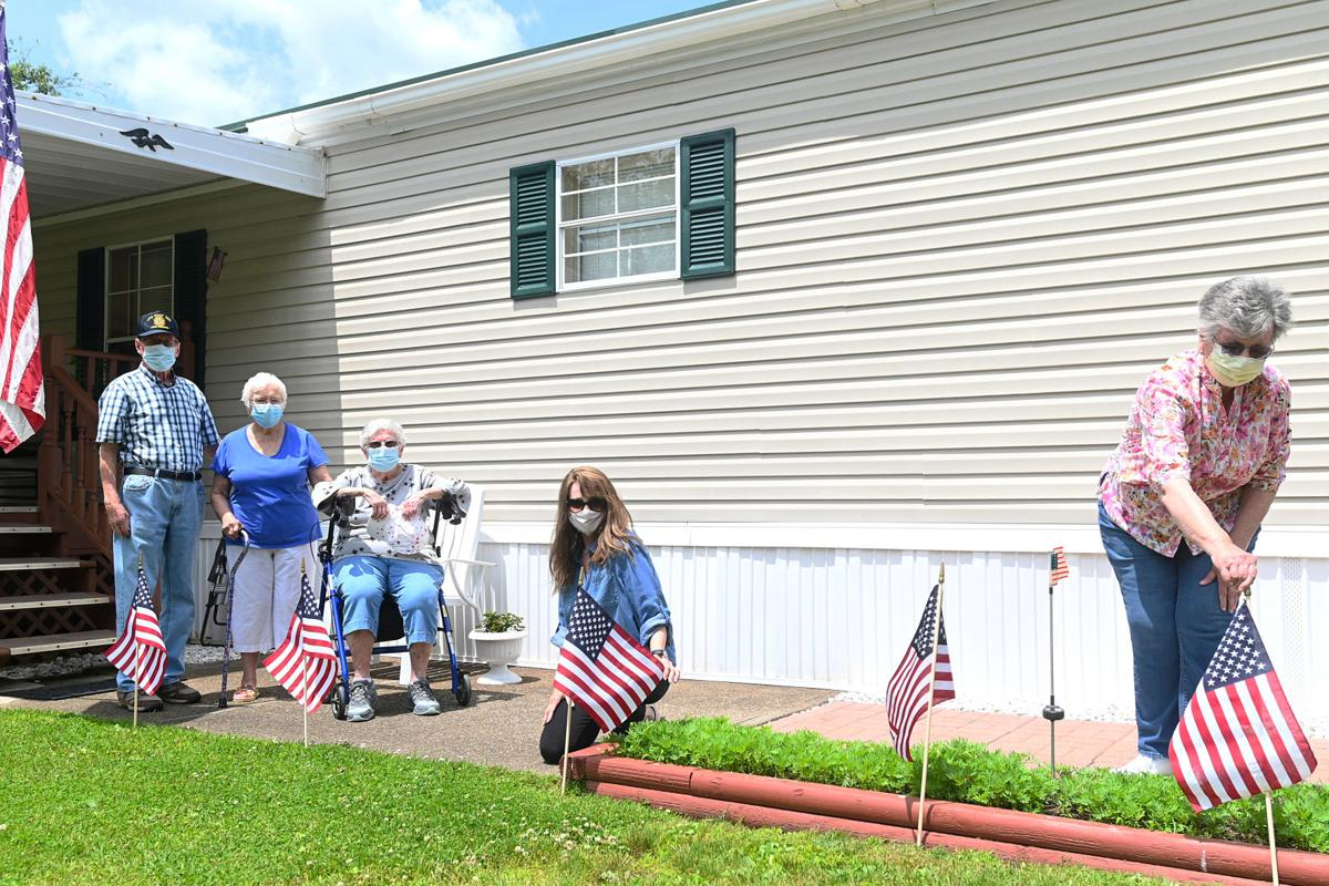 VFW Ladies Auxiliary places American flags