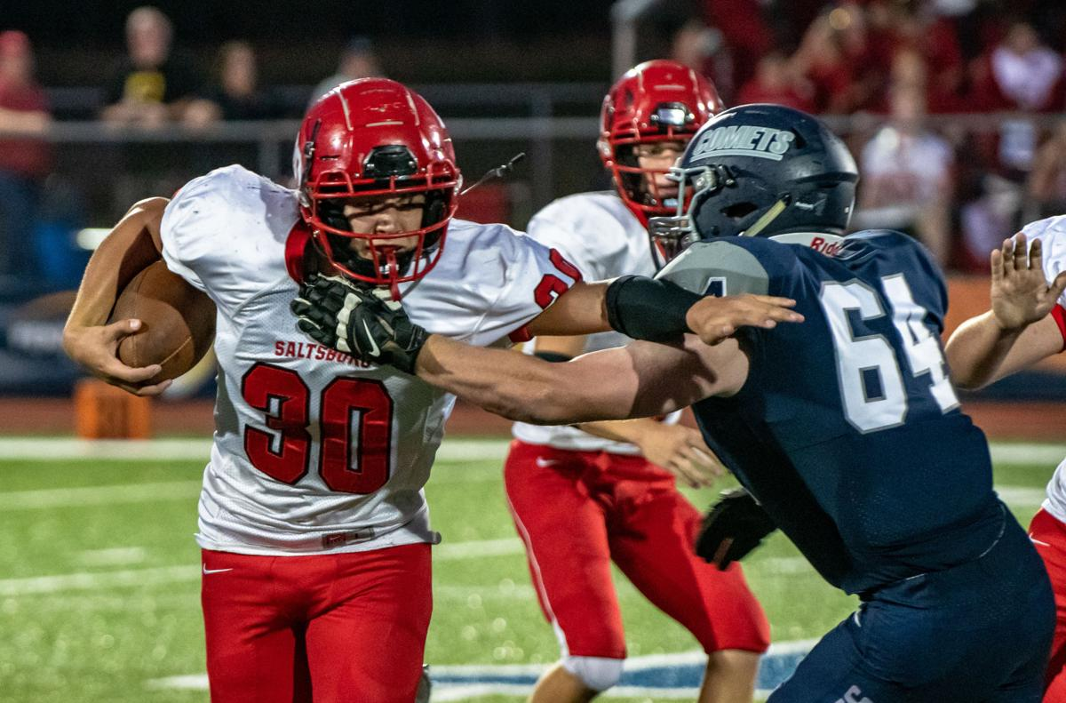 Gazette Photo Gallery: Trojans hold off Comets' late charge