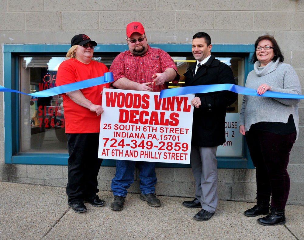 ribbon cutting held for indiana sign maker