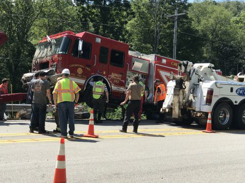 Firetruck rolls down embankment responding to crash on Route