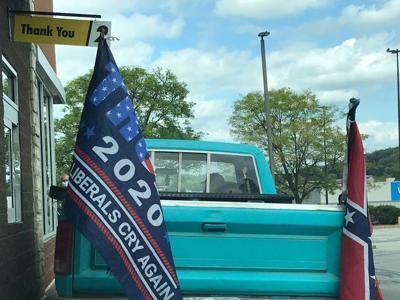 truck sporting a Confederate flag
