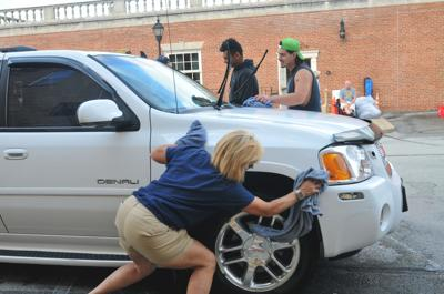 Gazette Photos: Car wash benefits holiday festival