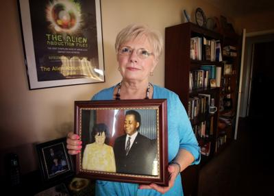 Kathleen Marden holds a picture of her aunt, Betty Hill, and her uncle, Barney Hill