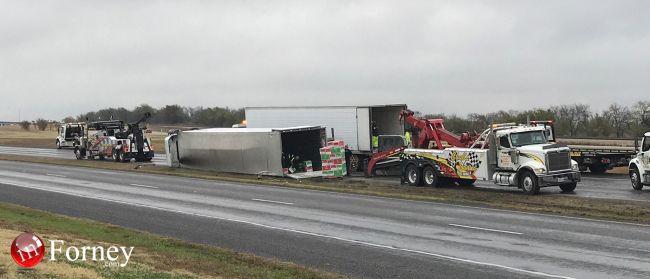 Eastbound U S  Highway 80 remains closed as crews offload overturned