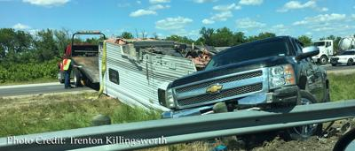 Overturned bumper-pull camper trailer causing delays on U.S. Highway 80