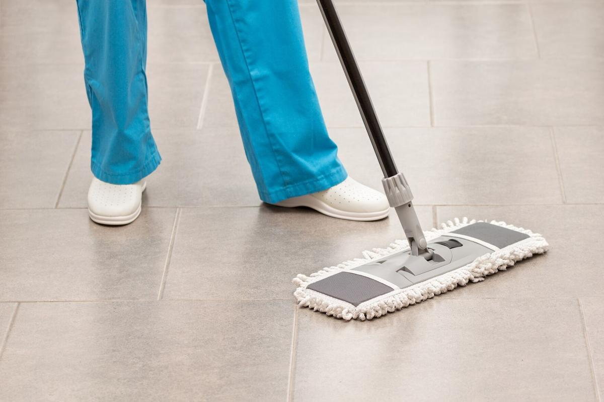 woman mopping the office floor