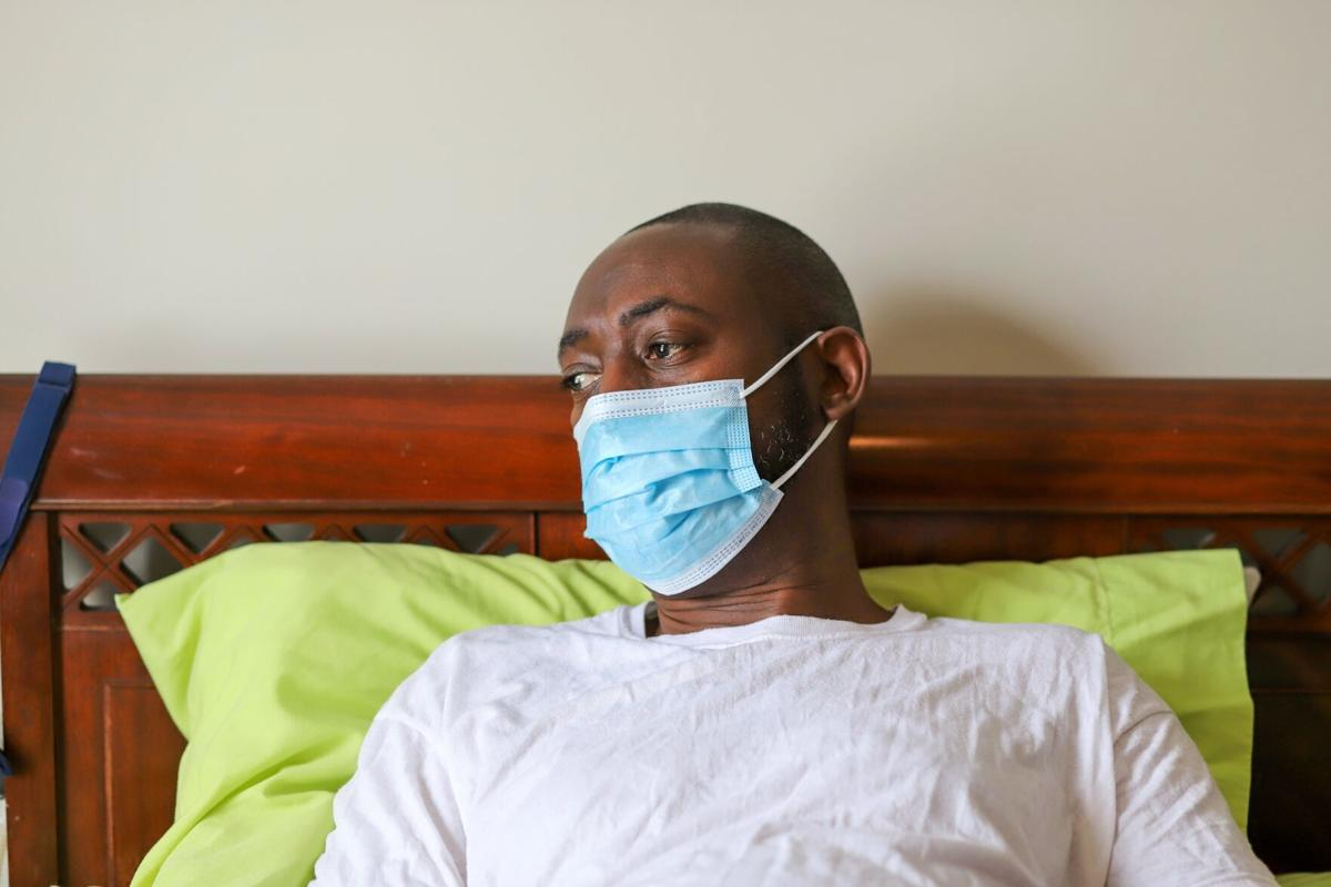 An African-American man wearing a protective face mask to prevent virus infection