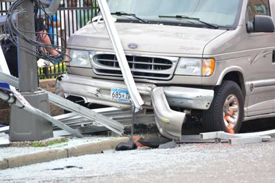 Six injured, three critical after van plows into bus shelter