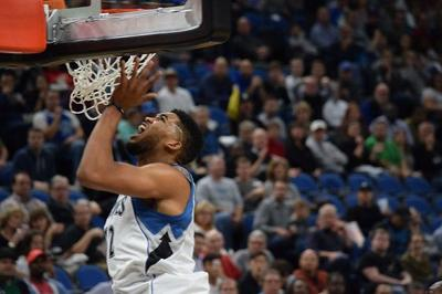 Timberwolves win home opener in a rout
