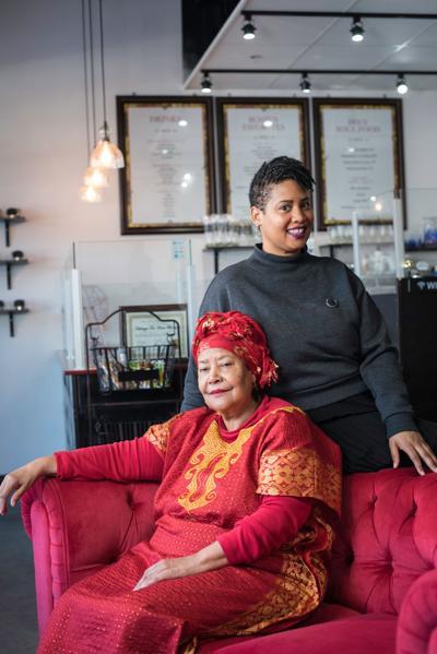 Heritage Tea House owners Raeisha Williams (standing) and Rosemary Nevils' Williams