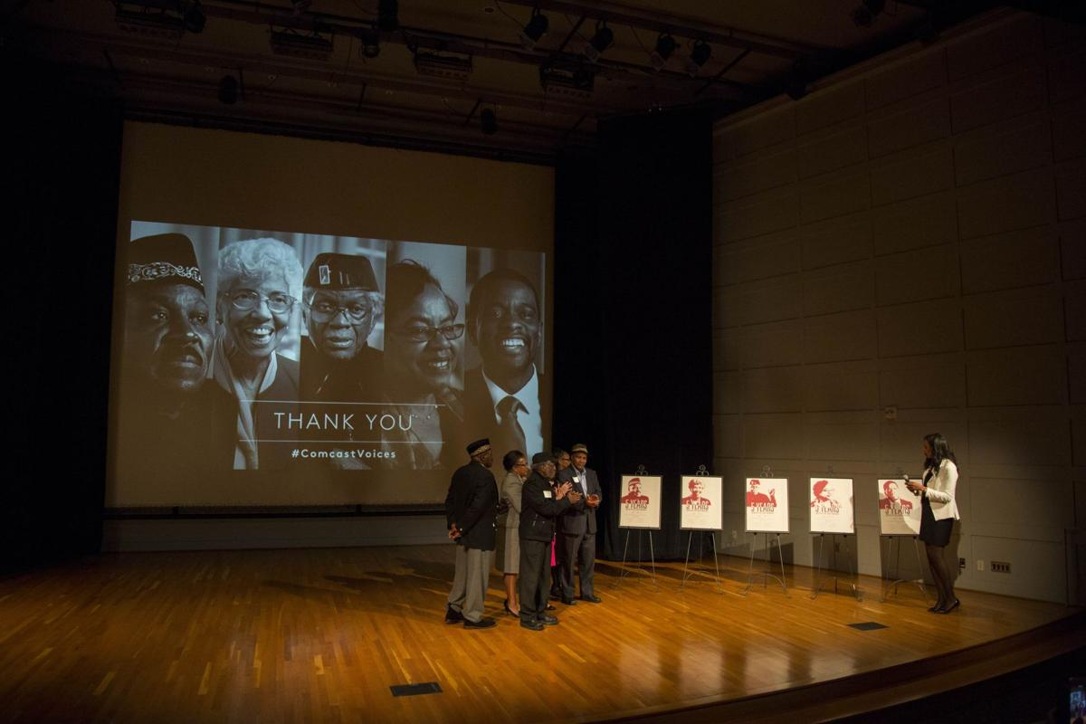 Long shot - Ebonne presents prints to group on stage.jpg