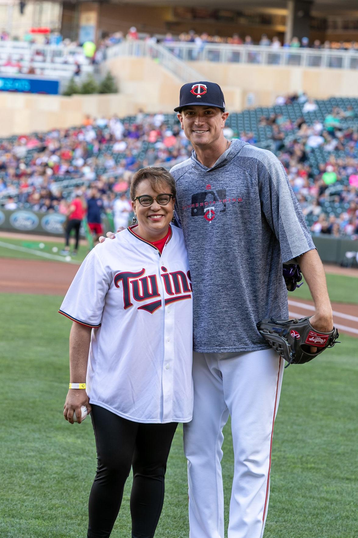 Duchess Harris with pitcher Kyle Gibson.jpg