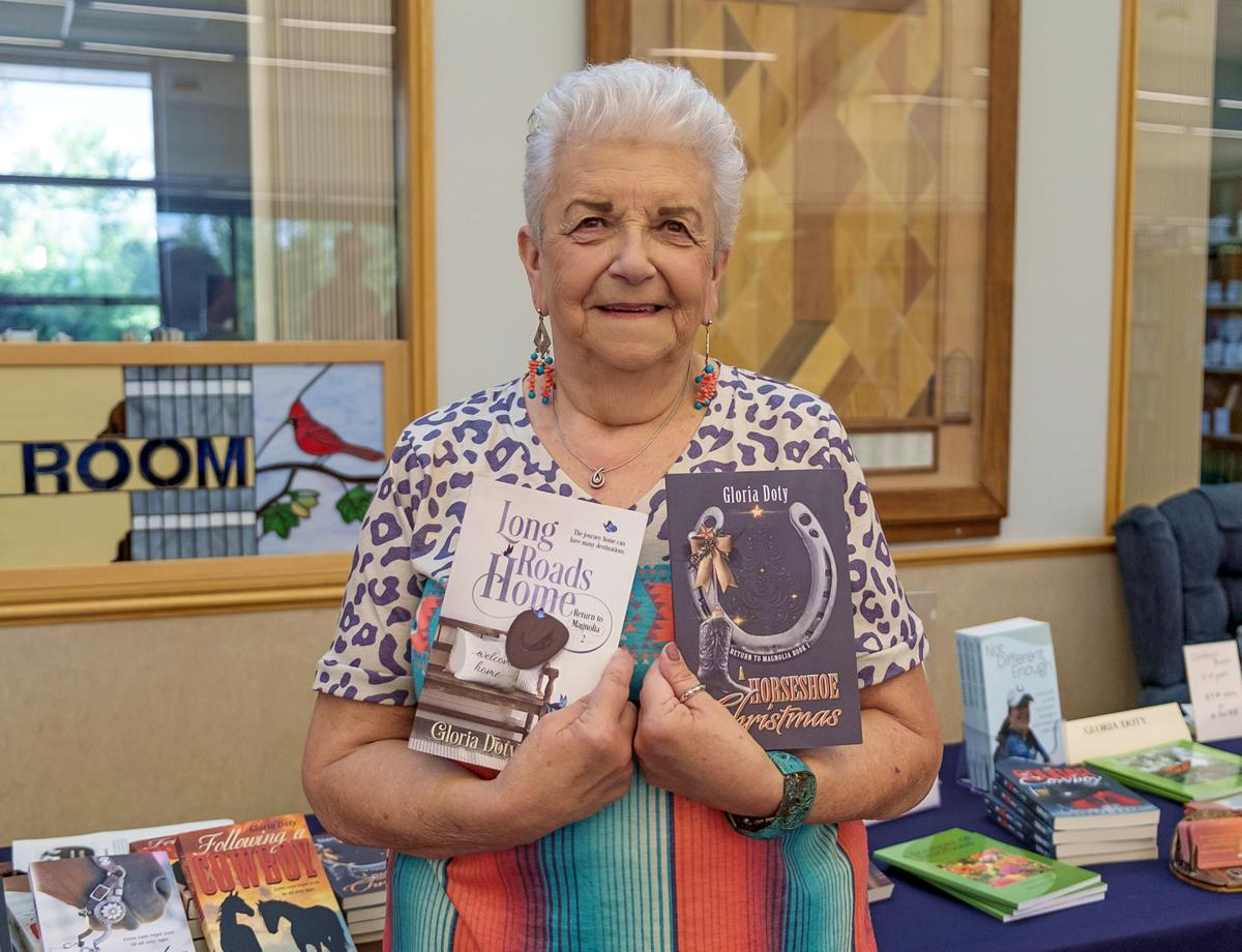 Author Gloria Doty holds two of her books.jpg