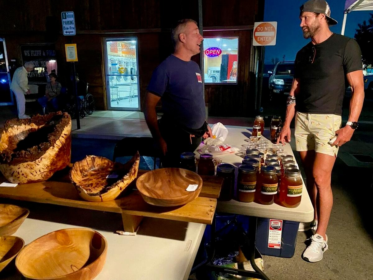 First Friday Night Market Chris Costello selling his honey and wood turned bowls.jpeg