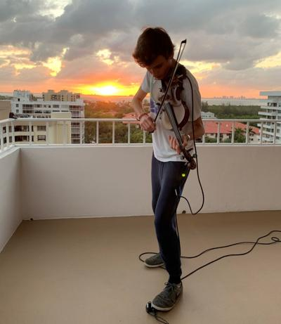 Young violinist a sumptuous escape for condo residents