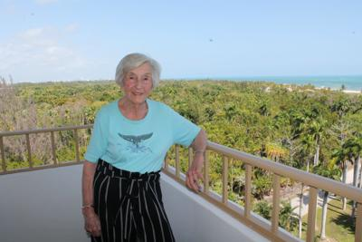Luisa Brightman enjoys the view on a spring afternoon from her balcony.