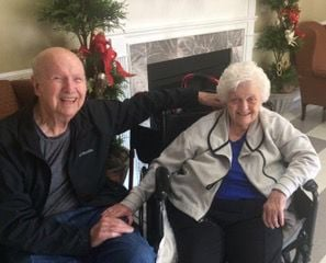 Hal and Charlotte Reaves. (Dad visiting Mom in her home)