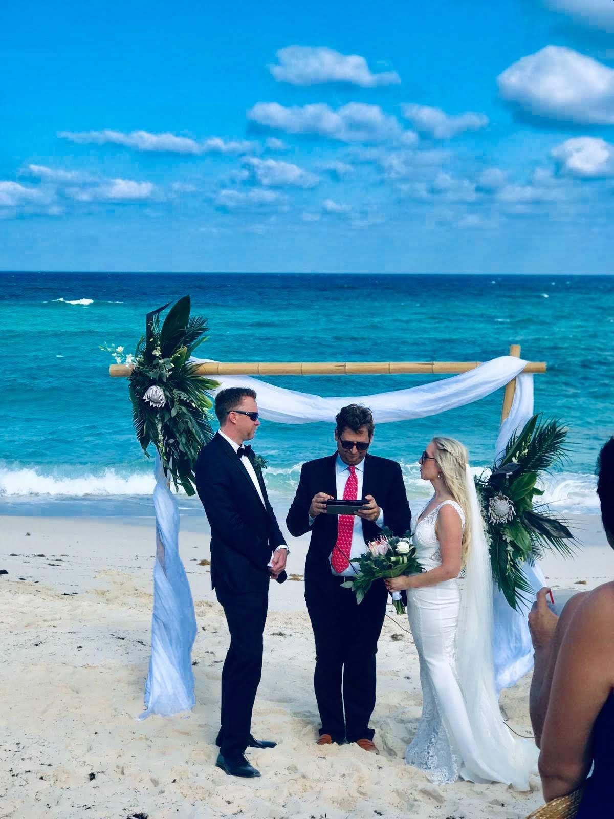 Ariana and Glenn Savage exchanging of vows officiated by Austin Tellam.