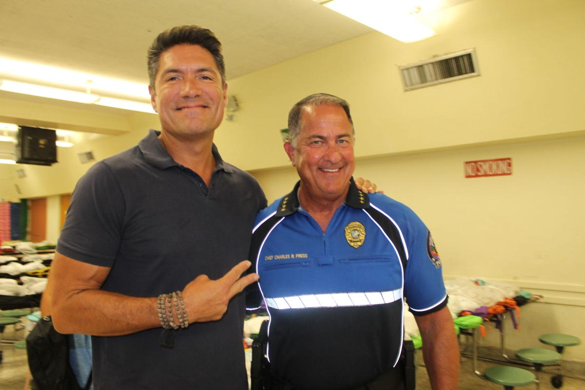 KBPD's Chief Charles Press with WPLG Channel 10 Anchor Louis Aguirre at recent Back to School Jam.